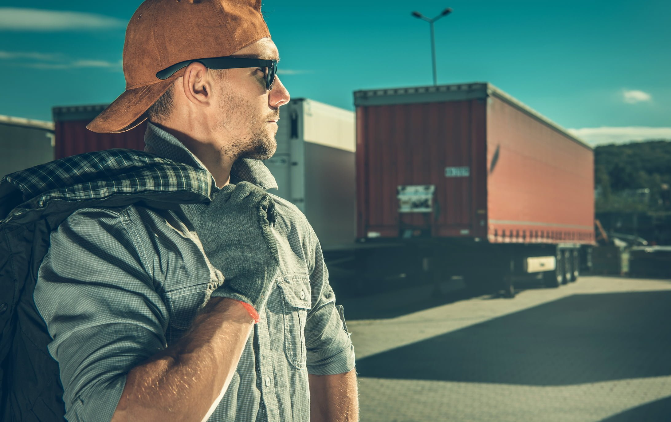 CDL Driver standing in front of 18-wheeler